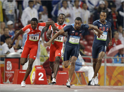 On the final handoff of the men's relay, the United States' Darvis Patton (right) was set to hand off to Tyson Gay (2nd from right).