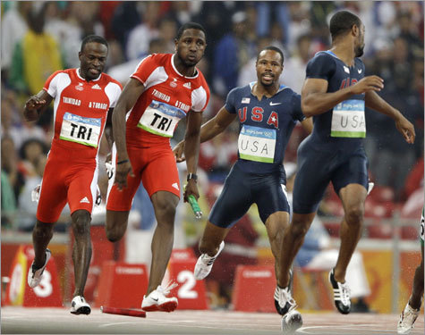 Tyson Gay (right) looked behind him at the fallen baton, while a stunned Darvis Patton looked on.