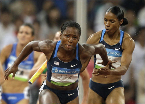 In the women's relay, the United States' Torri Edwards (right) and Lauryn Williams were the culprits in a failed handoff.
