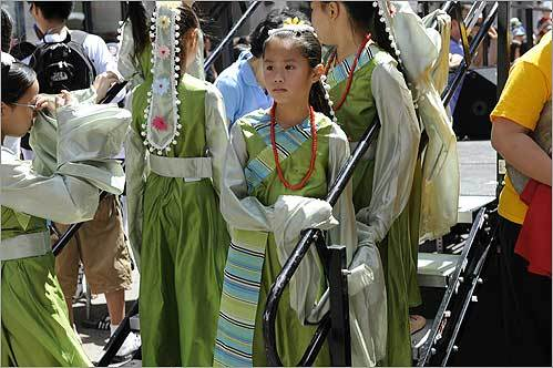 Diana Khuu, 8, of Boston (center), waited to perform with the Kwong Kow Chinese School during the August Moon festival held in Boston's Chinatown.