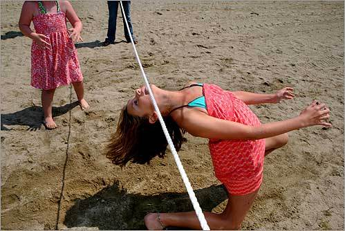 Lindsay Shannon, 10, of Savin Hill did the limbo during the Dorchester Beach Festival at Malibu Beach.