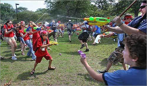The red shirts fought the blue shirts in a squirt gun battle on the Esplanade, sponsored by Banditos Misteriosos.