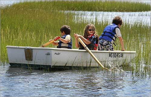 At Long Wharf, Max Murdock, 5, and his siblings Michaela, 8, and Andrew, 9, practiced their rowing skills in their family's dingy.