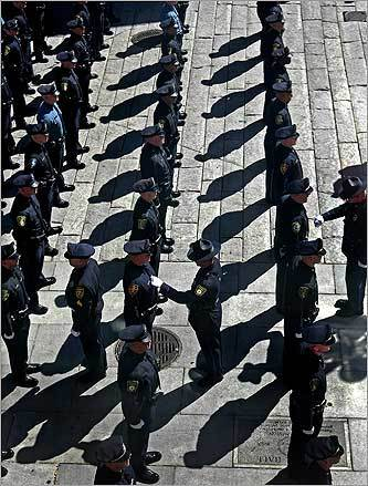 The 21st Municipal Police Officer's Class of the MBTA Transit Police Academy got a final inspection in a graduation ceremony at Faneuil Hall in Boston.