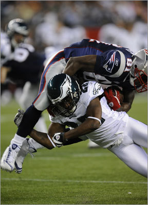 Philadelphia's Asante Samuel upends former teammate Randy Moss in the first quarter of Friday's game.
