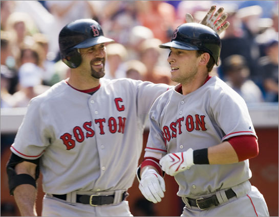The captain and the kid: Jason Varitek salutes rookie Jed Lowrie for his 11th-inning homer, the first game-winner of his career.