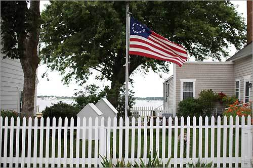 Old Glory flutters in a tidy, seaside neighborhood in Westport, Mass., which is on the South Coast about 60 miles from Boston.