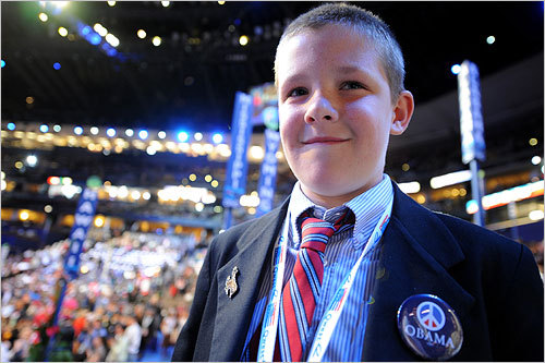 Patrick Millin, 10, a page with the Wyoming delegation, listened to a speech at the second day of the Democratic National Convention. Carrying the theme of 'America's Promise,' the event featured a lineup of Democratic Party heavyweights, including convention keynote speaker Mark Warner and Senator Hillary Clinton.