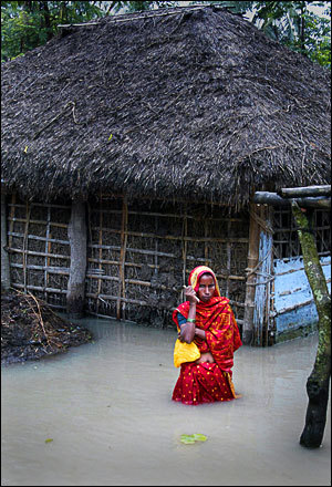 An Indian villager stands in flood water in Sitpur in the Supaul district of India's northern state of Bihar on August 28, 2008. Massive flooding in eastern India has caused a 'national calamity,' the prime minister said on August 28.
