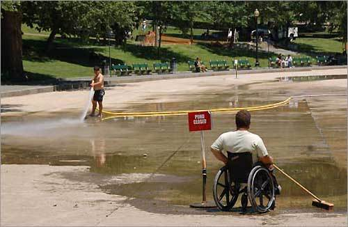 Workers clean the Frog Pond on Boston Common. Submit your Boston photos