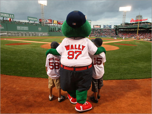 The sons of the late James W. Taylor, Jr., are introduced by Red Sox mascot Wally the Green Monster at last Friday's Red Sox-White Sox game. Weston, 9 (left) and Mason, 10, of Eagle Mountain, Utah, flew to Fenway to see their first Red Sox game. Click through this gallery to see their story, and read Stan Grossfeld's piece from Thursday's Globe .