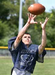 Plymouth North tailback Matt Brouillard, at practice, comes from one of many local football families devoted to their school.