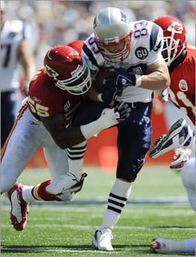 Patriots wide receiver Wes Welker ran for a gain as Chiefs line backer Pat Thomas made the tackle.