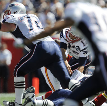 Brady's left knee buckled, and the Patriots quarterback fell to the ground.