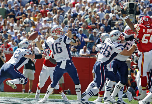 With Brady out of the game, Matt Cassel (center) took over for the Patriots at quarterback. With the Patriots backed up deep in their own territory to start Cassel's first drive, the backup QB completed a 50-yard pass to Randy Moss from his own end zone.