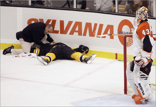 Patrice Bergeron Bergeron was checked into the boards face-first by Randy Jones of the Flyers during an Oct. 27, 2007 game in Boston. The 22-year-old Bergeron, who suffered a Grade 3 concussion and did not return again that season, was unconscious on the ice for 45 seconds.