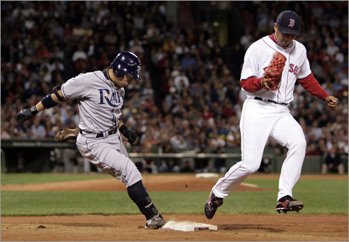 Hideki Okajima, shown beating Iwamura to first base for an out, pitched a scoreless seventh to keep the game tied.