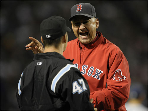 Sox manager Terry Francona can't believe Mike Lowell was called out on a fan interference play in the third inning.