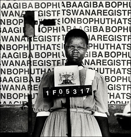 A woman is photographed in 1986 for her 'Reference Book' in Boputhatswana, one of the South African independent homelands.