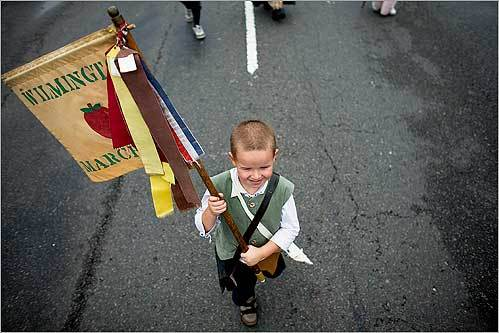 Cyrus Rich, 5, of Tewksbury, walked with the Wilmington Minutemen Company in the Allston-Brighton Day Parade in Allston September 14.