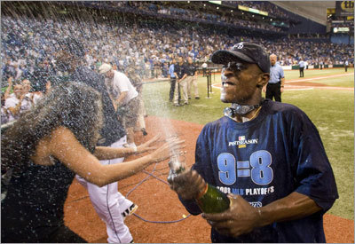 Tampa Bay Rays' B.J. Upton sprays champagne into the stands after the Rays clinched the franchise's first ever playoff berth during their American League baseball game against the Minnesota Twins in St. Petersburg, Florida September 20, 2008. REUTERS/Scott Audette (UNITED STATES)