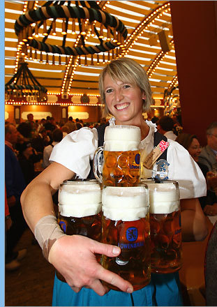 Waitress Barbara carries beers during the second day of the beer festival.