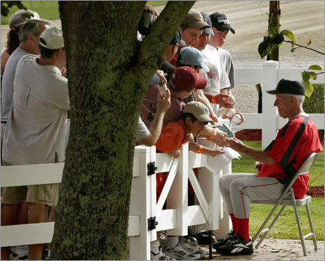 Johnny Pesky has been in some way connected to the Red Sox for 57 of his 69 years in baseball. Seen here signing autographs for fans at spring training in 2006, Pesky has been a fixture around the team since his playing days in the 1940s and '50s. With the Red Sox set to retire the 88-year-old Pesky's No. 6 on Friday (his 89th birthday is Saturday), we take a look back at his time with the Red Sox.