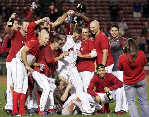 Red Sox players pose for a picture during the on-field celebration.