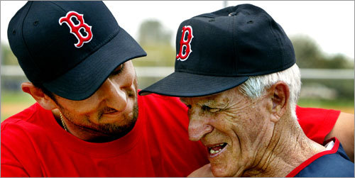 A dedication On March 3, 2004, the Sox dedicated one of the fields at their minor league complex to Pesky. Here Sox shortstop Nomar Garciaparra (left) gives Pesky a hug and a smile.