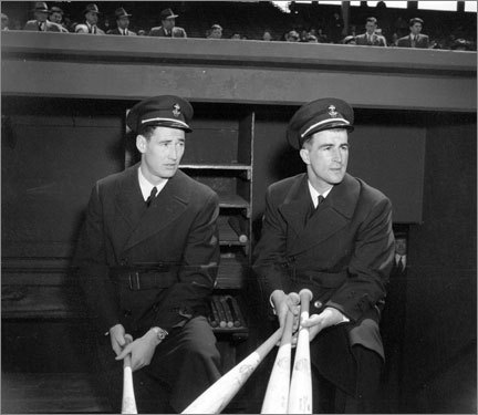 Military service Seen here wearing their U.S. Navy uniforms, Ted Williams (left) and Pesky watched the action from the dugout between the Red Sox and New York Yankees at Fenway Park April 27, 1943. The two were visiting as U.S. Naval Aviation Cadets. Pesky missed the 1943-45 seasons while serving in World War II.