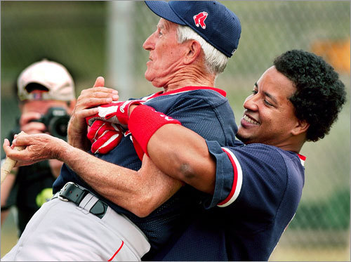 A fixture Pesky has been popular with Red Sox players through the years. Here, on his first day in camp in 2002, Sox outfielder Manny Ramirez picked Pesky up off the ground, his way of saying hello.