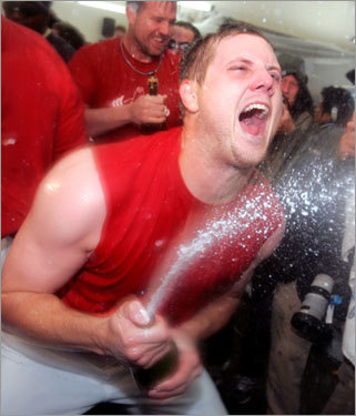 The only thing Papelbon does better than close out opponents is celebrate. Here he lets loose with a bottle of champagne.