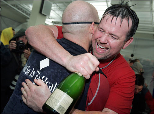 Sean Casey (right) hugs Kevin Youkilis in the clubhouse after the Red Sox clinched a playoff spot.