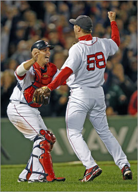 Red Sox closer Jonathan Papelbon and catcher Kevin Cash celebrate after Papelbon recorded the final out against the Indians on Tuesday night at Fenway.