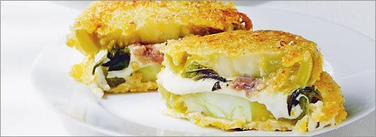 NEVER TOO RICH Green tomato 'sandwiches' - filled with mozzarella and fried in a cornmeal crust - are sophisticated mix of salty, creamy, and tangy.