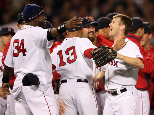 Jason Bay (right) is new to the postseason celebration ritual, but David Ortiz is ready to show him how it's done.