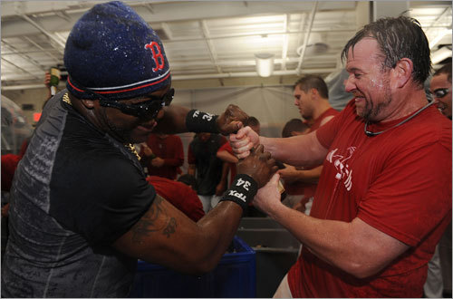 David Ortiz and Sean Casey celebrate in the locker room.