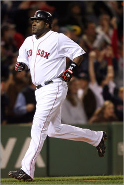 David Ortiz scores on a Kevin Youkilis homer that put the Sox on the board, 2-0.
