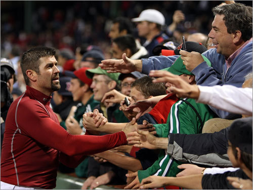 Jason Varitek took a lap around the field, shaking hands with fans along the way.