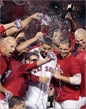 A group of Red Sox, including Mike Lowell (center), let the good times flow after clinching a playoff berth.