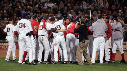 A group shot of the Red Sox celebrating after the final out of the game.