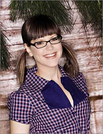 Folk singer Lisa Loeb sported dark-rimmed glasses years before Sarah Palin became a household name.