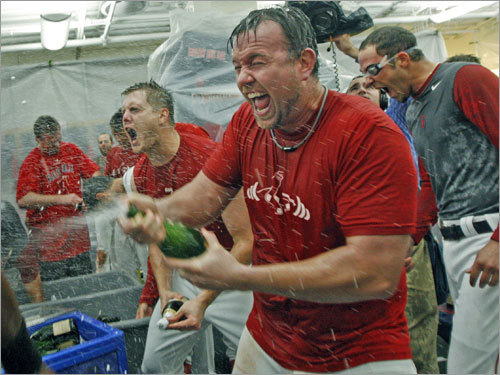 Sean Casey sprays teammates with champagne following Tuesday's win.