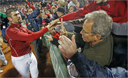 Red Sox catcher Jason Varitek celebrates with the fans.