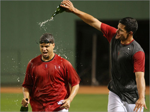 Manny Delcarmen (left) gets a champagne shower from teammate Javier Lopez.