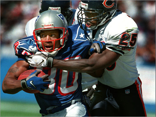 Brown busted out against Chicago in September 1997, catching 6 passes for 124 yards, including this completion after which he was finally brought down by Bears cornerback Tom Carter (25).