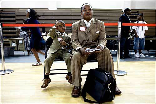 Brunel Devonette, of Malden, and his son Angelo, 4, waited before performing their gospel music during the New England Haiti Hurricane Relief Fund Activities held at Roxbury Community College in the Reggie Lewis Track and Athletic Center Sept 21.