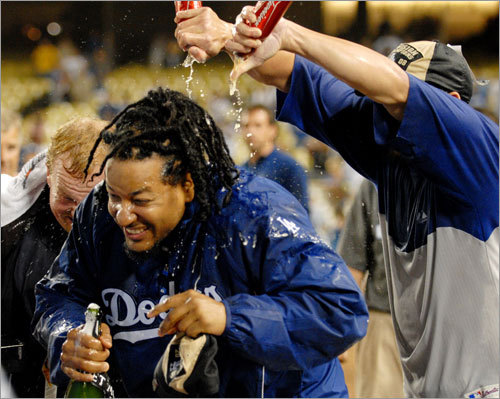 Manny Ramirez gets sprayed after Thursday's game against the Padres in Los Angeles. The Dodgers clinched the title without lifting a bat. Entering the day with a magic number of one, they got what they needed when the second-place Arizona Diamondbacks lost 12-3 at St. Louis in the afternoon.