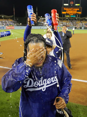 Manny Ramirez celebrates clinching the National League West title after the game against the San Diego Padres at Dodger Stadium Thursday night.