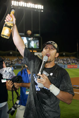 Former Red Sox shortstop Nomar Garciaparra celebrates clinching the National League West title after the game against the San Diego Padres at Dodger Stadium Thursday.